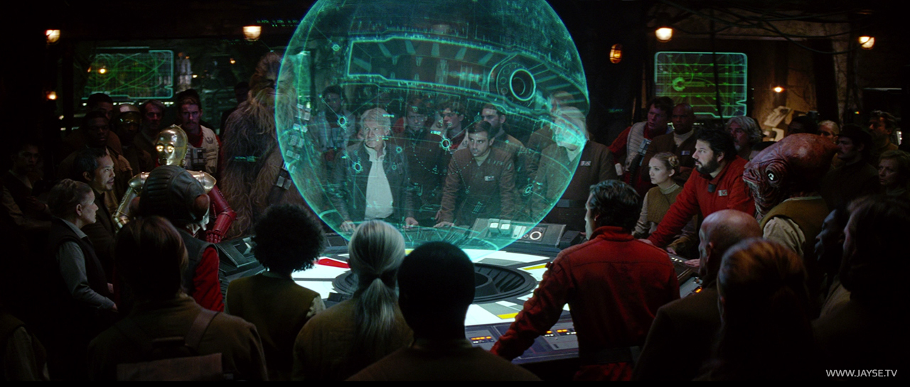 Han Solo and crew gather around the Starkiller Base Hologram in The Force Awakens
